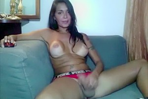 Naughty shemale strokes her hard cock